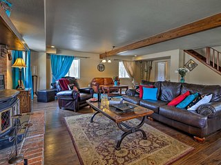 The great room has rich hardwood floors, plush sofas, and fashionable decor.