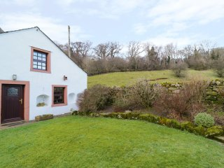 GARDENERS COTTAGE is located on a working farm in the village of Hesket Newmarke