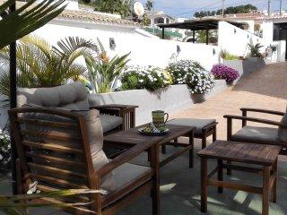 Luxe  appartement met tropische tuin prive met zwembad
