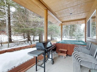Homey retreat with a private hot tub, deck space, golf course views, and more