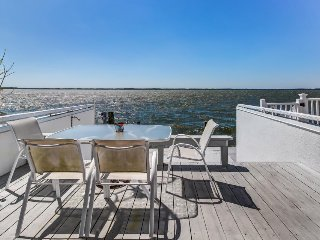 Stunning bayfront home features boat slip and great location for exploring!