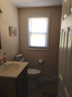 Full bath with shower and tub.  Additional outside shower as well.