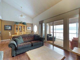 Lakefront condo w/ enclosed balcony, lovely views & shared seasonal pool/beach!