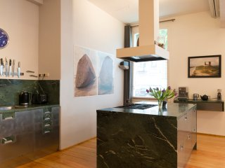 Cooking island of green marble from Italian alpes.