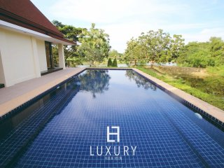 Bali style pool villa with 7 bedrooms on Palm Hills golf course.