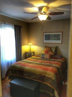 Upstairs bedroom with queen