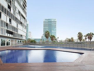 Beachfront Apartment with a Swimming Pool and a Large Terrace - B237