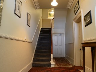 Stunning pillowed edged stone flooring throughout the main entrance, staircase leads to first floor