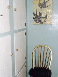 Dressing chair in bathroom.