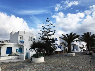 Local living in Mykonos windmills