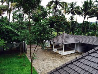 Garden villa- Waves and Shores, Thiruvaniyoor - Bedroom 1