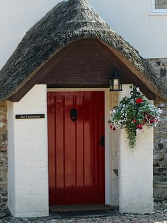 Thatched and covered porch to The Farmhouse