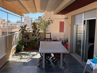 Very convenient and sunny penthouse close to the beach (15 min on foot)