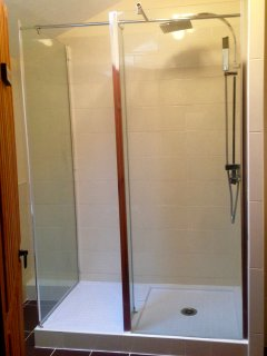 The modern upstairs bathroom complete with overhead shower