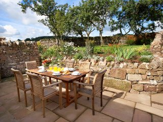 Wythburn's private front terrace overlooks an old orchard garden w/teak garden furniture & Weber BBQ