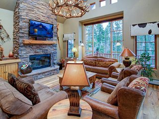 Ski-in/ski-out at this elegant, 3-story chalet w/ deck, hot tub, & fireplaces