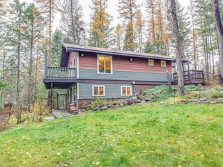 Waterfront home with cozy wood stove, deck, and private pond!