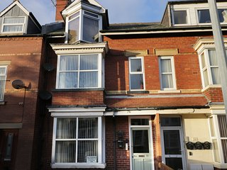 FLAT 2, first floor flat, off road parking, pet-friendly, five mins to coast, in