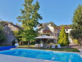 Beautifully restored stone house with fantastic views, mature gardens and pool