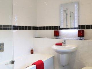 Modern refurbished bathroom with shower over bath.