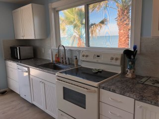 Fully remodeled kitchen overlooking bay.