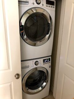 Full size stacked washer/dryer.