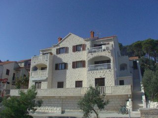 Two bedroom apartment Postira (Brač) (A-700-b)
