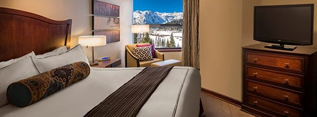 Master bedroom with en-suite bathroom and breathtaking views of Squaw Valley.