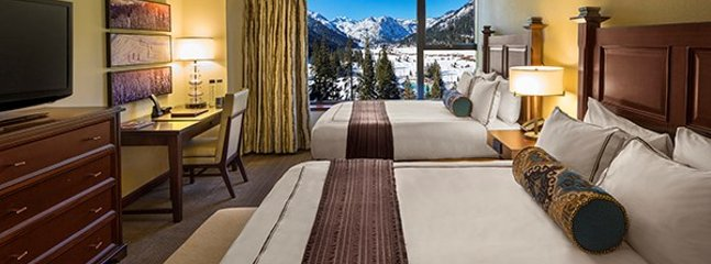 The second room with two queen beds and en-suite bathroom with amazing mountain view.