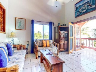 Breezy seaside condo in oceanfront property with a shared pool and more!