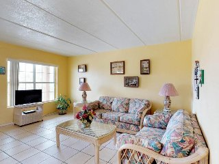 Cute, dog-friendly condo near the beach with shared pool!