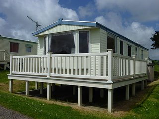 Beautiful holiday home with panoramic coastal views near sandy beach.