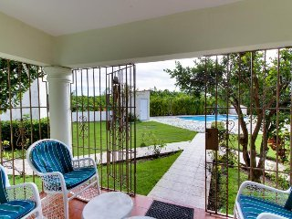 Dog-friendly condo - a half-mile from the beach with shared pool & swim-up bar