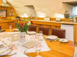 The vaulted ground floor room houses the kitchen and dining room