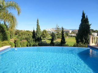 Fantastic villa with hot tub, Infinity pool and great views over the golf course