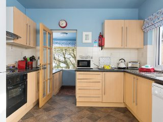 Kitchen with adjoining full laundry facilities.  Magnificent views of Belfast Lough over garden.