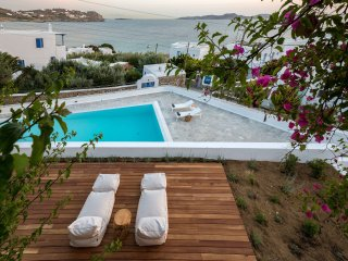Sun deck with pool and sea views