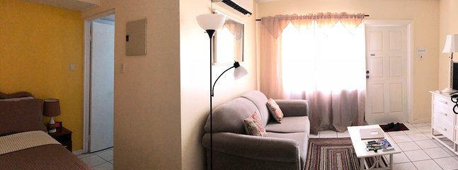 Pano view .  Ensuite bathroom. Sofa bed (double) . Air conditioner.