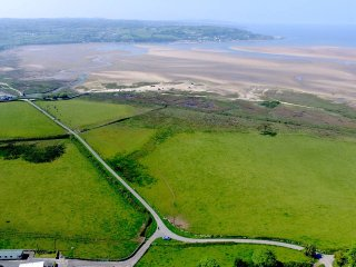 Only a short walk from the sandy expanse of Traeth Coch/Red Wharf Bay.