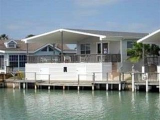 2/2 Waterfront Home, relax, fish, or golf in this gated family friendly resort.