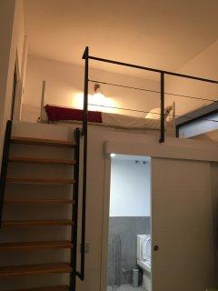 Vista altillo habitación cama individual