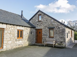 TY BUDDUG, stone-built cottage, character features, hot tub, woodburner