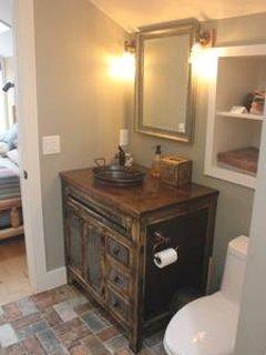 Esty bathroom cabinet and light fixtures with copper bucket sink