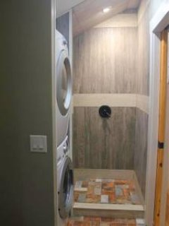 Shower with stacker laundry