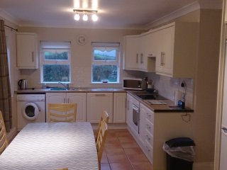 Fully equipped kitchen with large dining area.