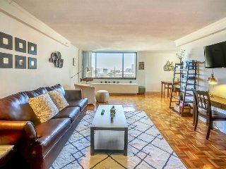 Spacious, modern condo with private balcony and shared pool!