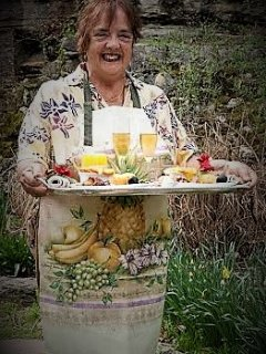 Sandra gives elf Carl a break from delivering to your door her famed Optional 'Gourmet Breakfast'