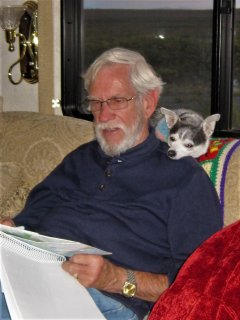 Casita-keeper Carl, on an RV trip,works on his Great American Memoir as his best critic looks on