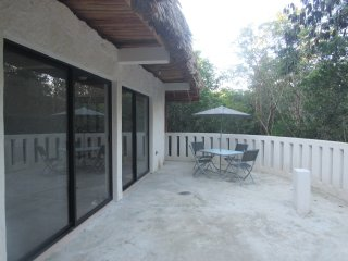 outdoor patio surrounded by trees is great for bird watching and excellent sunsets.