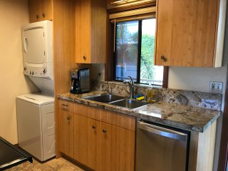 Brazilian granite countertops, stainless double sink, water filter, dishwasher, washer dryer